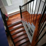 Contemporary stairs, tiger wood treads, wrought iron, 6500 rail,  painted handrail,