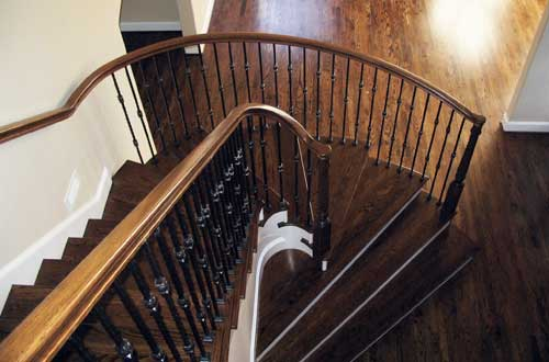 Custom Curvy Wrought Iron and Wood Stair Remodel